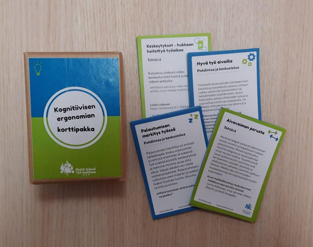 Valova kognitiivisen ergonomian korttipakasta ja korteista.